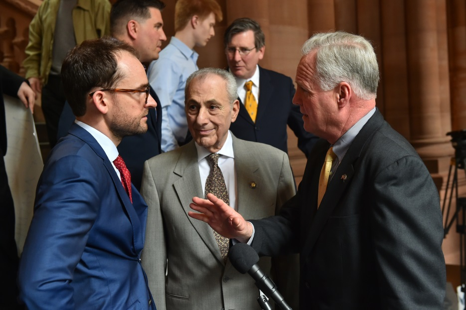 Assemblyman Michael Fitzpatrick (R,C,I,Ref-Smithtown), right, speaks with Brandon Muir, executive director of Reclaim New York, left, and colleague Assemblyman Joseph Errigo at a press conference held
