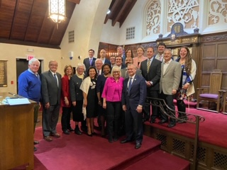 Assemblymember Lavine stands with his colleagues and friends at Temple Beth El of Great Neck at a special service organized by Senator Anna Kaplan.