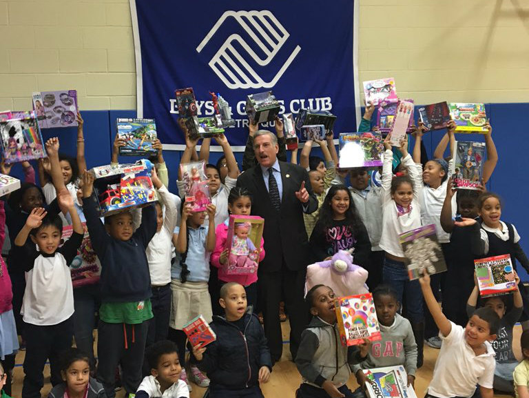 Children join Assemblyman David Weprin and display gifted toys from the Assemblyman�s Holiday Toy Drive to benefit the Boys & Girls Club of Metro Queens.