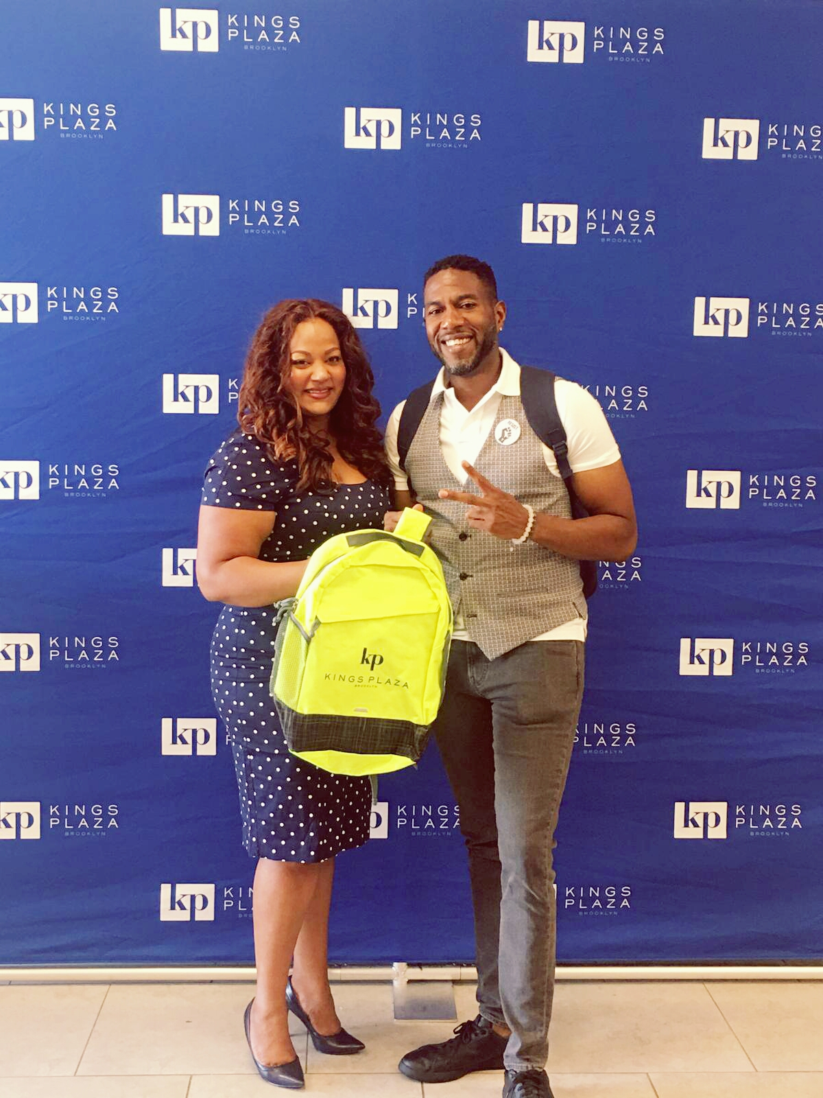 Collecting Backpacks for students at Kings Plaza's Back to School Backpack Giveaway with Public Advocate Jumaane Williams.
