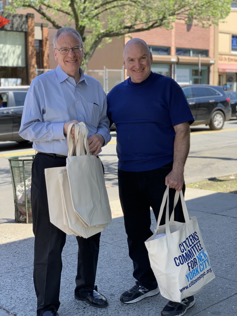 Assemblyman Jeffrey Dinowitz with a neighborhood resident excited to get a free reusable canvas bag from Citizens Committee of New York City along Johnson Avenue.