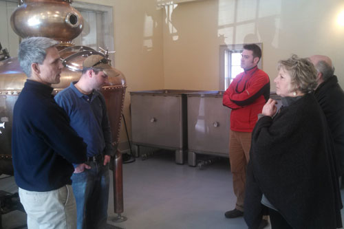 Barrett talking to Jeff Baker, owner of Hillrock Estate Distillery in Ancram, during one of the stops in her 'Where the Jobs Are' Tour.