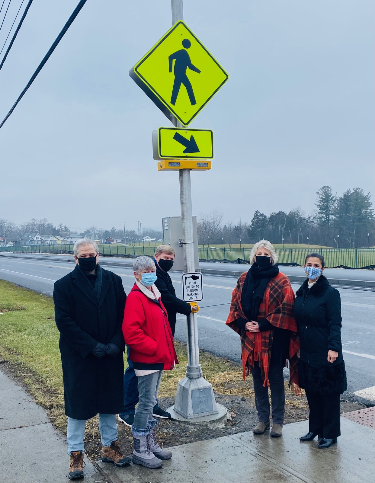 Assemblymember Barrett unveils a new solar-powered crosswalk in Hudson with representatives of the Hudson City School District and Hudson Common Council. From left – City of Hudson Fifth Ward Alderman