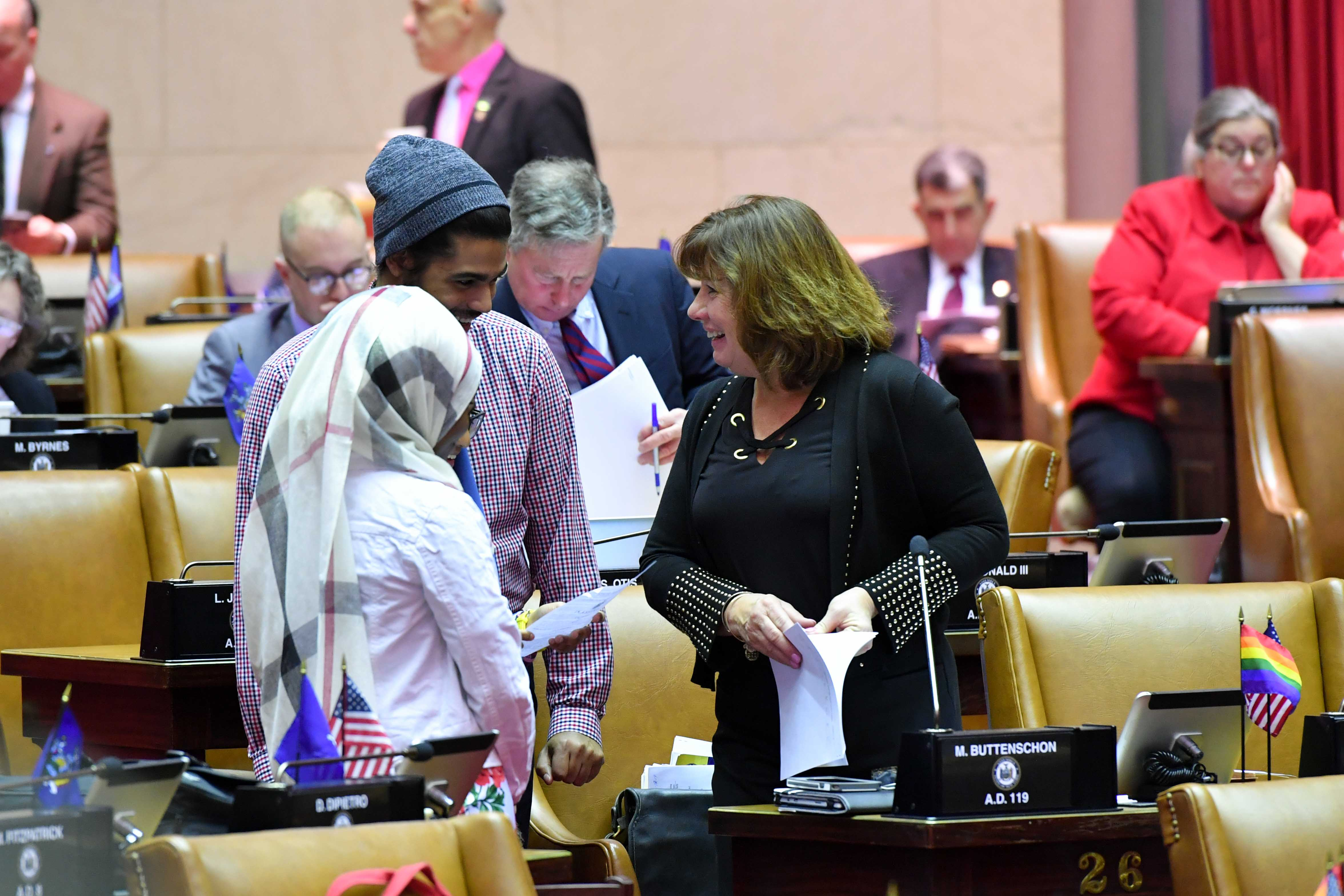 Assemblywoman Buttenschon on the floor of the Assembly with students from Mohawk Valley Community College C-Step Program.