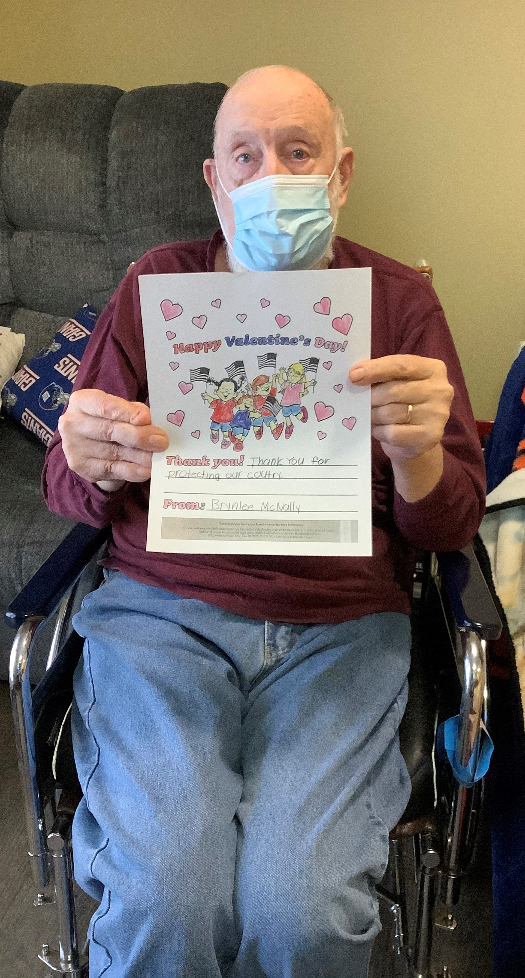 A Veteran admiring his Valentine's Day Card thanks to Assemblywoman Buttenschon's Valentines for Vets.