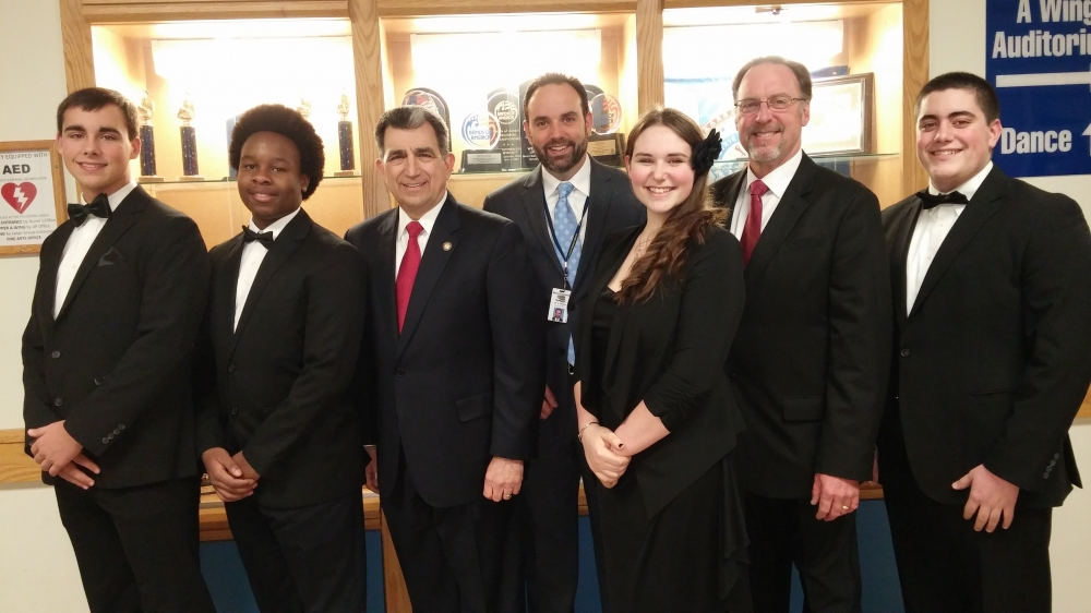 Assemblyman Magnarelli, Superintendent Dr. Chris Brown, and Director of Fine Arts Bill Davern posed with high school band members prior to the concert.
