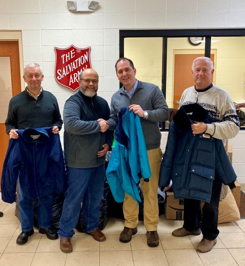 Assemblyman Mike Norris (second from right) drops off winter clothing items that were collected from the community as part of his annual drive. Standing with the assemblyman are Salvation Army Major J